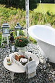 Tray of toiletries on low side table next to open-air bathtub