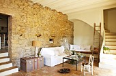 Foot of masonry staircase and masonry steps in timeless, converted interior of old, Spanish property