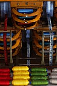 Colourful rolls of yarn in loom