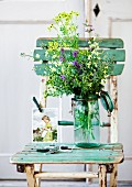 Kitchen garden bouquet and old-fashioned photo of girl on vintage chair