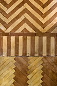 Multicoloured parquet floor in different bond patterns