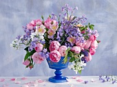 Summer bouquet of roses, bluebells, sweet rocket, stocks and forget-me-nots