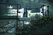 Romantic seating area - cushions and candles on stone benches surrounded by wrought iron balustrades (Schloss Schauenstein)