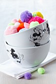 Mickey Mouse bowls filled with colourful pompoms