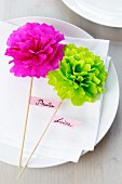 Name tags with tissue paper pompoms