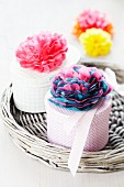 Gift boxes decorated with tissue paper pompoms