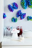Tissue paper party decorations on wall