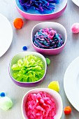 Colourful bowls & pompoms decorating table