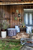 Stools made from thick pieces of tree trunk on wooden terrace