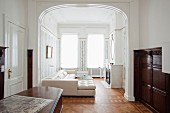 White leather sofa combination in grand period apartment with artistic wall panelling and elegant parquet floor