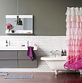 Pink ruched shower curtain in grey and white bathroom