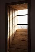 Wood-clad window niche with barred window