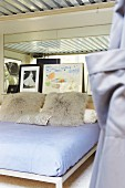 Pillows on a bed in the bedroom with corrugated iron lining