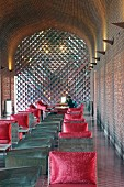 Devi Ratn Hotel - lobby with monolithic, sandstone furniture and red cushions