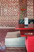 Devi Ratn Hotel - monolithic piece of furniture with red table top in lobby