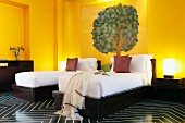 Devi Ratn Hotel - yellow room with twin beds