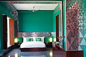 Devi Ratn Hotel - green room with double bed