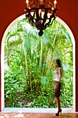 View of lush, exotic plants through rounded archway