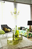 Vases and flowers on plexiglass tables, wicker chair with wire frame and floral, retro, 70s-style sofa