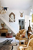 Foyer in English country-house-style with collection of traditional and bizarre accessories