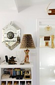 Postmodern wall clock and table lamp with leopard-print lampshade on small set of shelves