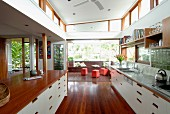 Wood, stainless steel and white fronts in open-plan kitchen in spacious interior