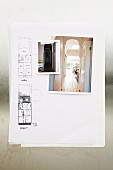 Photo of interior and floor plan diagrams on sheet of paper