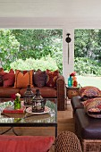 Living room with rattan-leather sofas and glass top coffee table