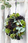 Autumnal door wreath of eucalyptus, hydrangeas and elderberries