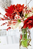 Winter bouquet with amaryllis and sprigs of winterberry