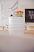 Dishes and plates stacked on table