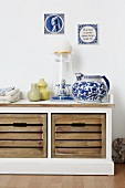 Storage bench with Dutch ornaments and jugs