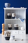 Dutch cups on kitchen shelving