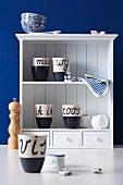 Dutch cups on kitchen shelving
