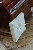 Envelopes bound with silk ribbon leaning on antique letter rack