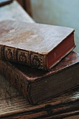 Antiquarian books with gilt embossing on worn leather bindings