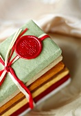 Gourmet Chocolate Bars Wrapped in Elegant Textured Paper; Stacked and Tied