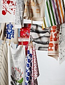 Colourful tea towels hanging on washing lines