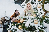 Couple celebrating Christmas in snowy forest