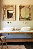 Marble washstand with twin basins below mirrors in vintage wooden frames