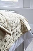 Beige quilt on bed