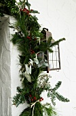 Christmas garland of pine and fir branches on house facade