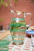 Glass jug of peppermint tea