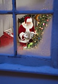 Santa Claus leaving gifts under Christmas tree