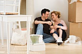 Couple drinking wine in new house