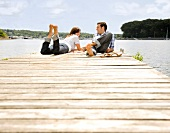 Couple laying on dock