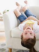 Child playing on sofa