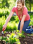 A young woman gardening