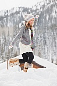 USA, Utah, Salt Lake City, young woman walking through snow in resort