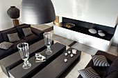 Coffee table in three sections and dark sofa set in contemporary living room